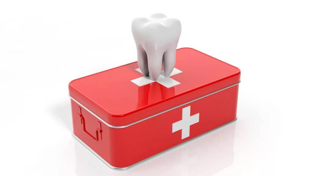Illustration of a white tooth on top of a red first aid kit